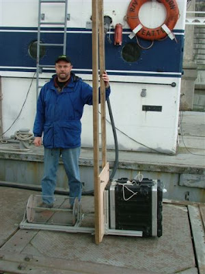 Hydrovolts founder Burt Hamner with Flipwing turbine and test equipment