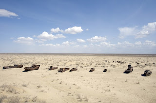 Rusted ships abandoned on the receded shore of the Aral Sea