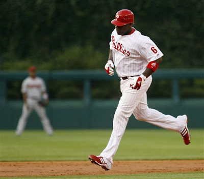 Ryan Howard rounding second after hitting his major-league-leading 28th home run