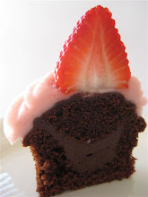 dark chocolate truffle filled chocolate cupcake with strawberry frosting
