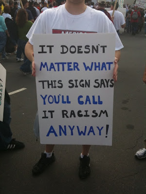 rally sign--it doesn't matter what this sign says you'll call it racism anyway