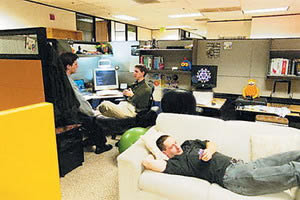 peoples workspaces are full of individuality and the atmosphere is relaxed there are couches everywhere people can have a lie down when they need to and atmosphere google office