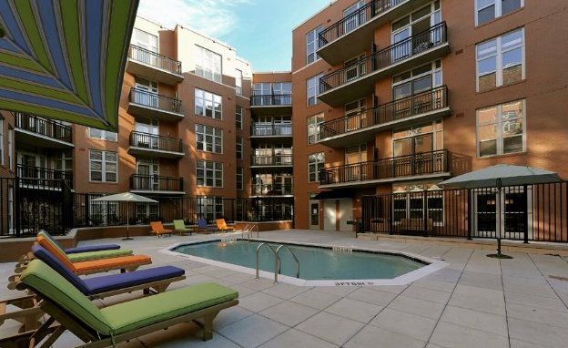 ... Apartments Have Been Leased. The Building Boasts A Communal Pool In The  Interior Courtyard And A Rooftop Deck; A Below Grade Parking Lot Has 410  Spaces.