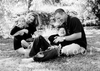 Keller Texas family portratit photography photo of fun family tickle session outdoors in park