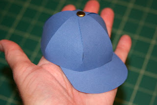 Step You can then cut a small paper square and glue it inside of the hat to make the top stick together Step Draw 6 circles for the breathing holes, cut them and glue them on the center of each panel Step Cut out a strip of paper and glue it together to make a cylinder Step