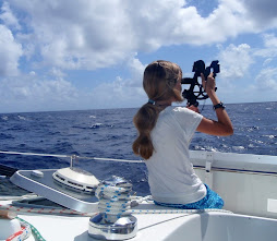 Shelby doing some shots on our crossing to the Tuamotus