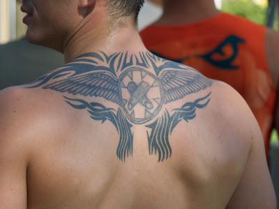 Symbols that often appear in angel tattoo designs include: tribal angels