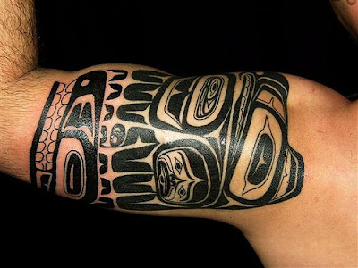 This work belongs to a typical totem tattoo, with crude and uncivilized