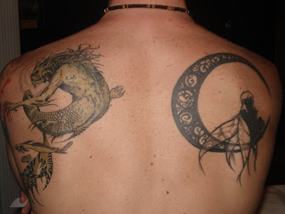 Tribal moon tattoos designs pictures 3- monster_and_moon_tattoo