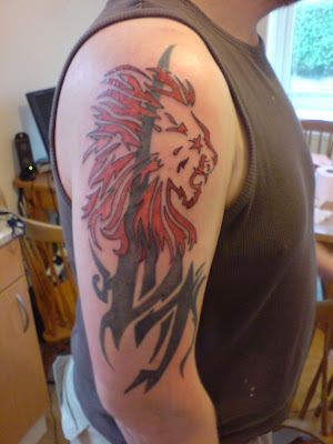 tribal tattoo tree. Red Tribal Lion Tattoo [Image Credit: Link]