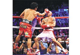 Pacquiao beats Cotto