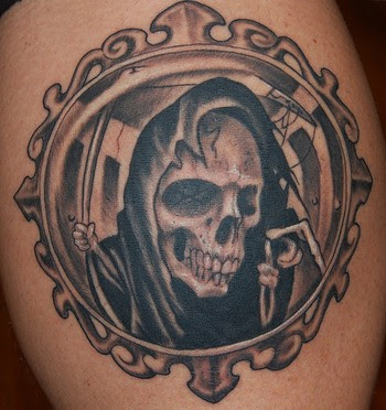 grim tattoo designs tattooing by using black and grey tattoo ink