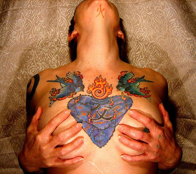 flowers tattoos on chest. chest tattoos,