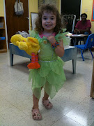 and she had a great time wearing a Tinkerbell costume. See?