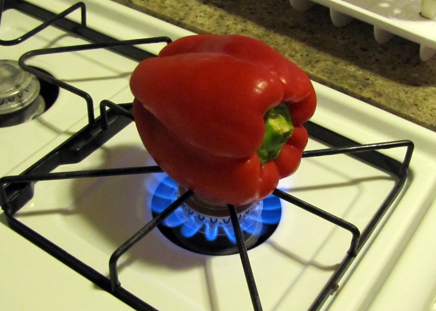 Red+bell+pepper+over+flame
