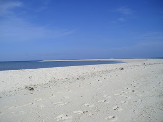Crescent Shaped white island in camiguin