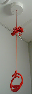 Emergency help cord tied up with cable tie near ceiling