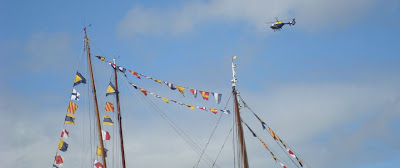 Police helicopter flies over the Tall Ships site