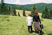 Katalan Varga and son Orbán walking through a field