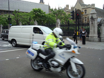 Police outrider escorting David Cameron part Parliament