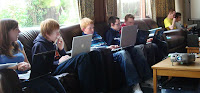 Tech Campers (and a leader) sitting with their laptops