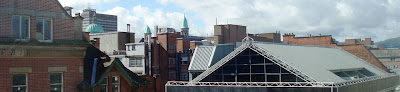 South westerly view across the Belfast city centre skyline from a third floor window of Freemasons Hall