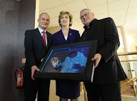 Artist Ian Fleming handing his jigsaw artwork to Irish President Mary McAleese at Ullans Academy's Columbanus Celebration