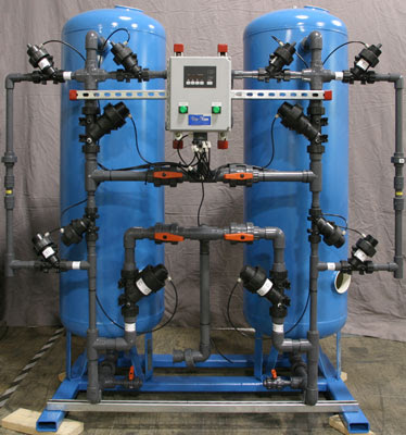 Dual alternating, skid mounted, water softener, including PVC interconnecting piping, GE Aquamatic composite diaphragm valve, GE Aquamatic 962 series controller and isolation valves.