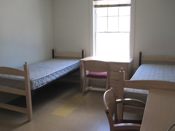 here is a typical dorm room with two beds two desks and two unseen