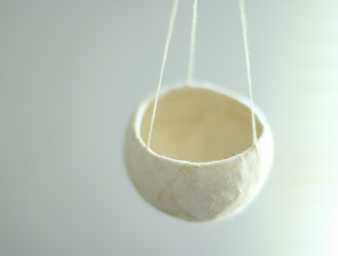 Hanging, 2007. dried gourd, thread & paper. 3.8 x 6.4 cm