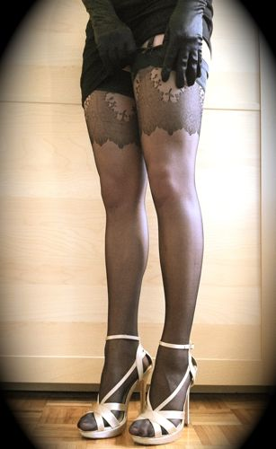 High heels, black stockings and garter belt