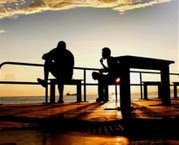 Reuters Photo: Two men watch the sunrise in the Solomon Islands, April 21, 2006. For people who...