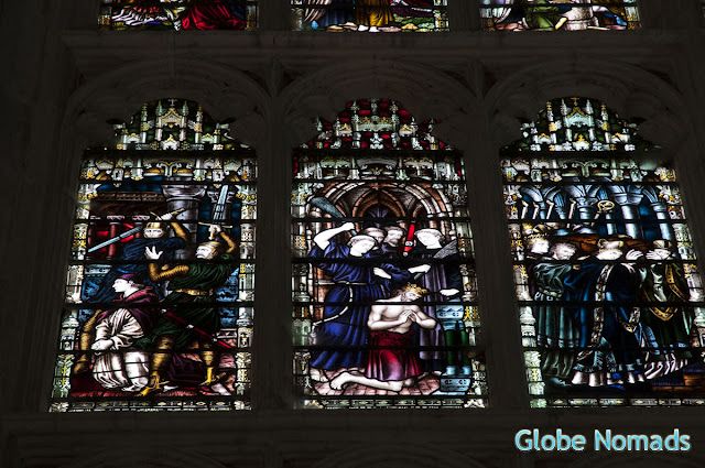stained glass window in chapter house of canterbury cathedral depicting the murder of Thomas Becket