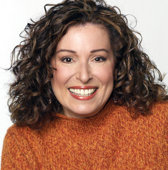 She has curly hair.