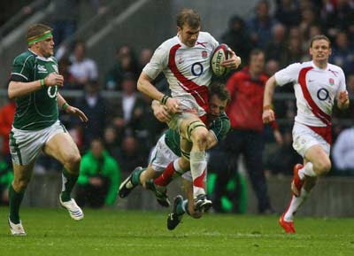 Tommy Bowe, the Hound of Ulster, catches a hould of Nick Easter at Twickers last year