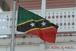 St. Kitts en Nevis, na exotische ploegen tijdens de openingsceremonie op de Olympische spelen, nu ook de vlag op de vaste wal van dit eilandduo