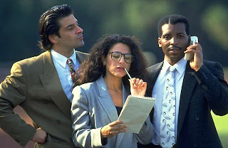 Three business executives outdoors