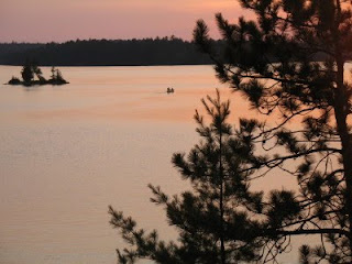 Canoeing at sunset on Weslemkoon Lake, Ontario, Canada