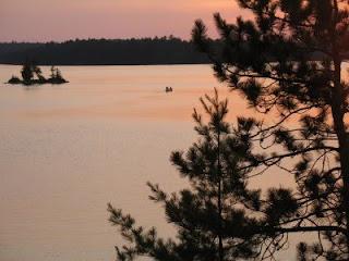 Canoeing at sunset on Weslemkoon Lake, Ontario, Canada
