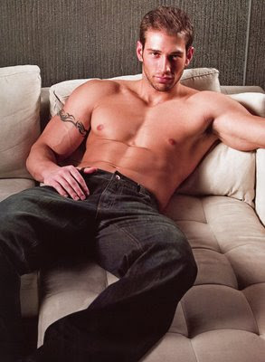 arm tattoo hunk in couch hunk in jeans