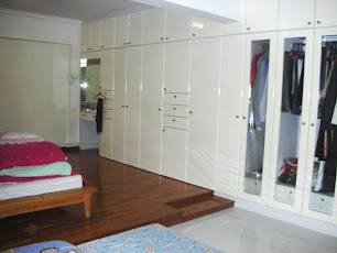 The rows of wardrobe in our master bedroom