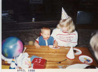 baby brother with cake smeared all over and 11 year old me