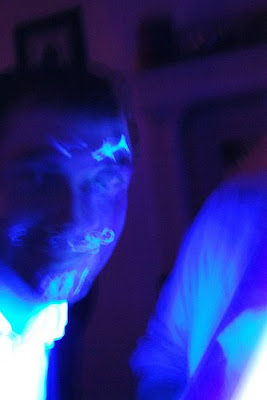 face with glowing eyebrows, mustache and goatee drawn on