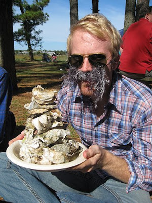 boy with walrus moustache and pile of oyster shells