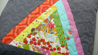 quilted triangle pillow