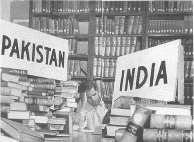 [Spitting_a_library_in_1947.jpg]