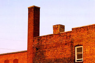 [Two threatened chimneys at the Creighton University campus]