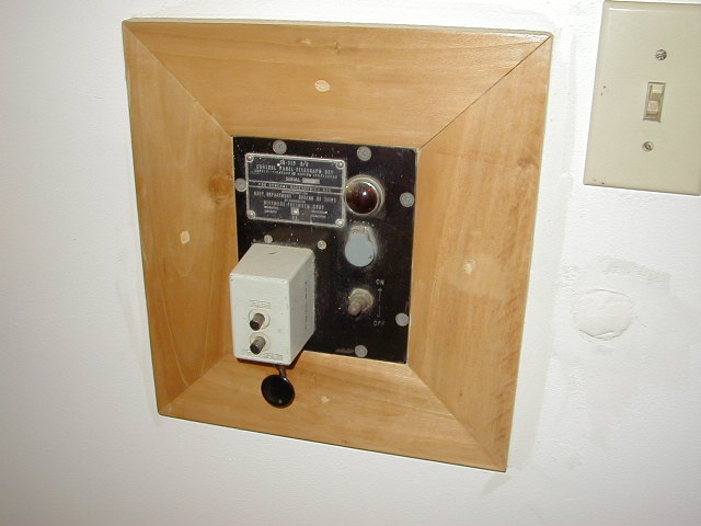 framed radio CW key, made by a late friend - garage door opener.   This is one of those memories.