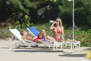 Nicollette Sheridan in red bikini spends Xmas day