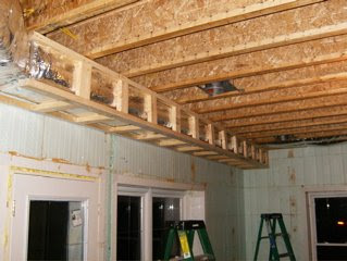 ductwork in the basement is now complete dwayne and jeff had to frame